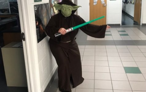 Astronomy teacher Michelle Bailey-Hennessey in her Yoda costume outside room 233 on Halloween.