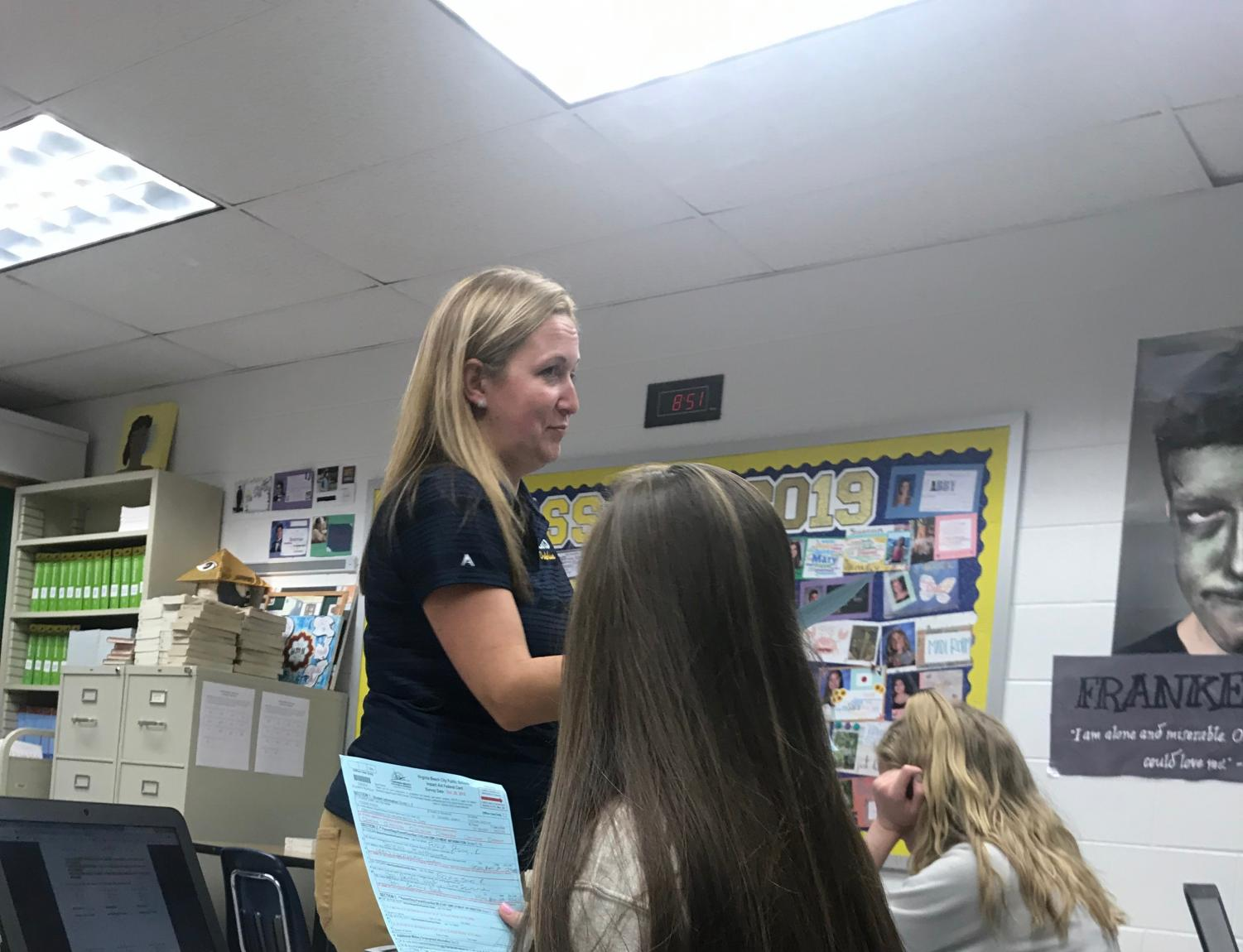 English teacher Jessica Scheible collects federal cards from her 2A study block on Nov. 2.