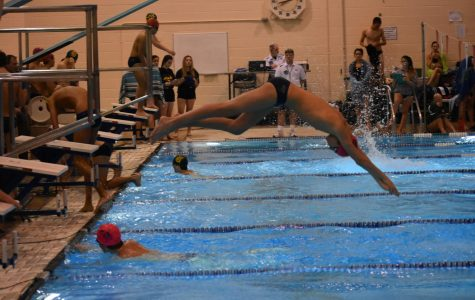Swim team takes victory over Cox