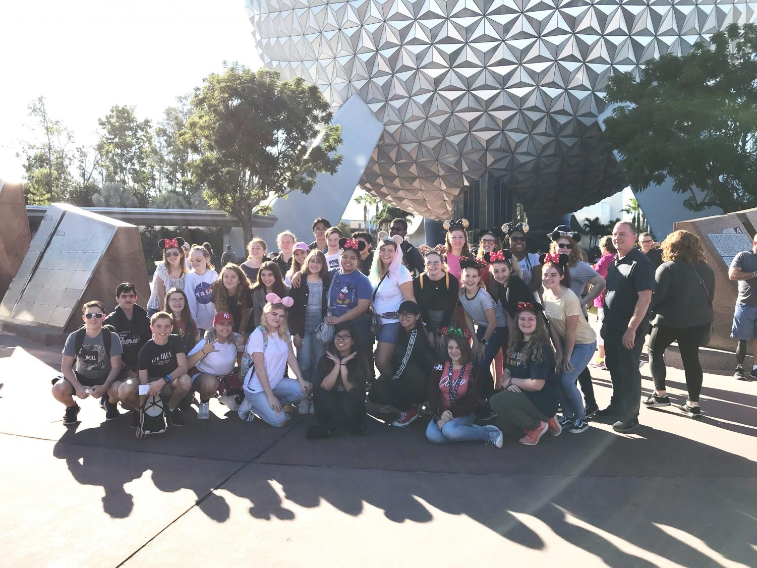 Chorus students stand in front of the Epcot Ball