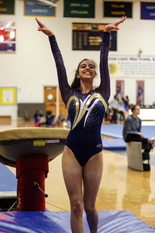 Senior captain Jessica Harris salutes the judges after a vault pass at the first meet on Dec. 13.