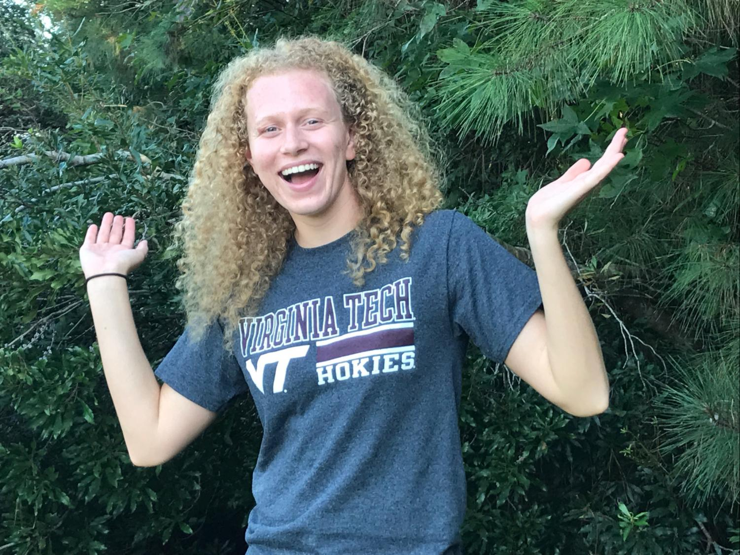 Senior Julia Smith takes picture in Virginia Tech shirt after committing. Photo on Sept. 30, 2018