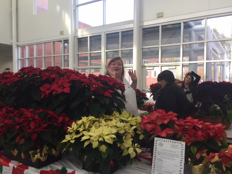 PTSA President Sandra McDonald waits patiently for her next customer at the auditorium foyer on Wednesday, Dec. 12.