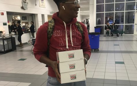 Senior Malik Thomas after buying donuts from the AVID stand in front of the cafeteria on Friday, Dec. 7.