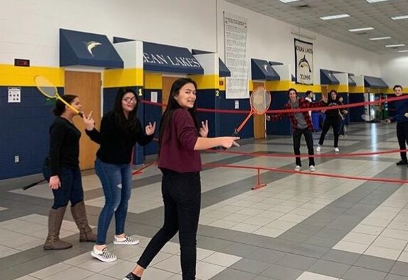 Badminton members pose for a picture before resuming a friendly match on Jan. 9 in the cafeteria.