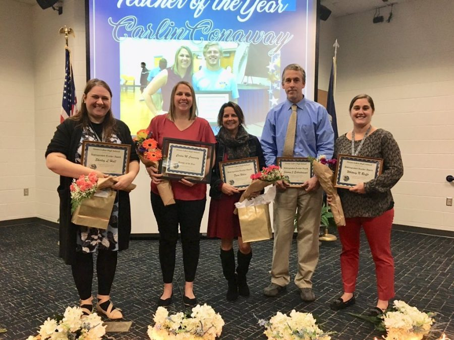 (From left to right) Teachers Shirley Hall, Carlin Conaway, Fara Wiles, Jeremy Schratwieser, and Whitney Raffo pose with the awards given to them at the Distinguished Teacher Ceremony on Jan. 11.