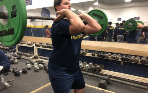 Junior football player Nathan Brunelle performs a power clean in the gym on Jan. 26, a great exercise to build muscle and increase heart rate.