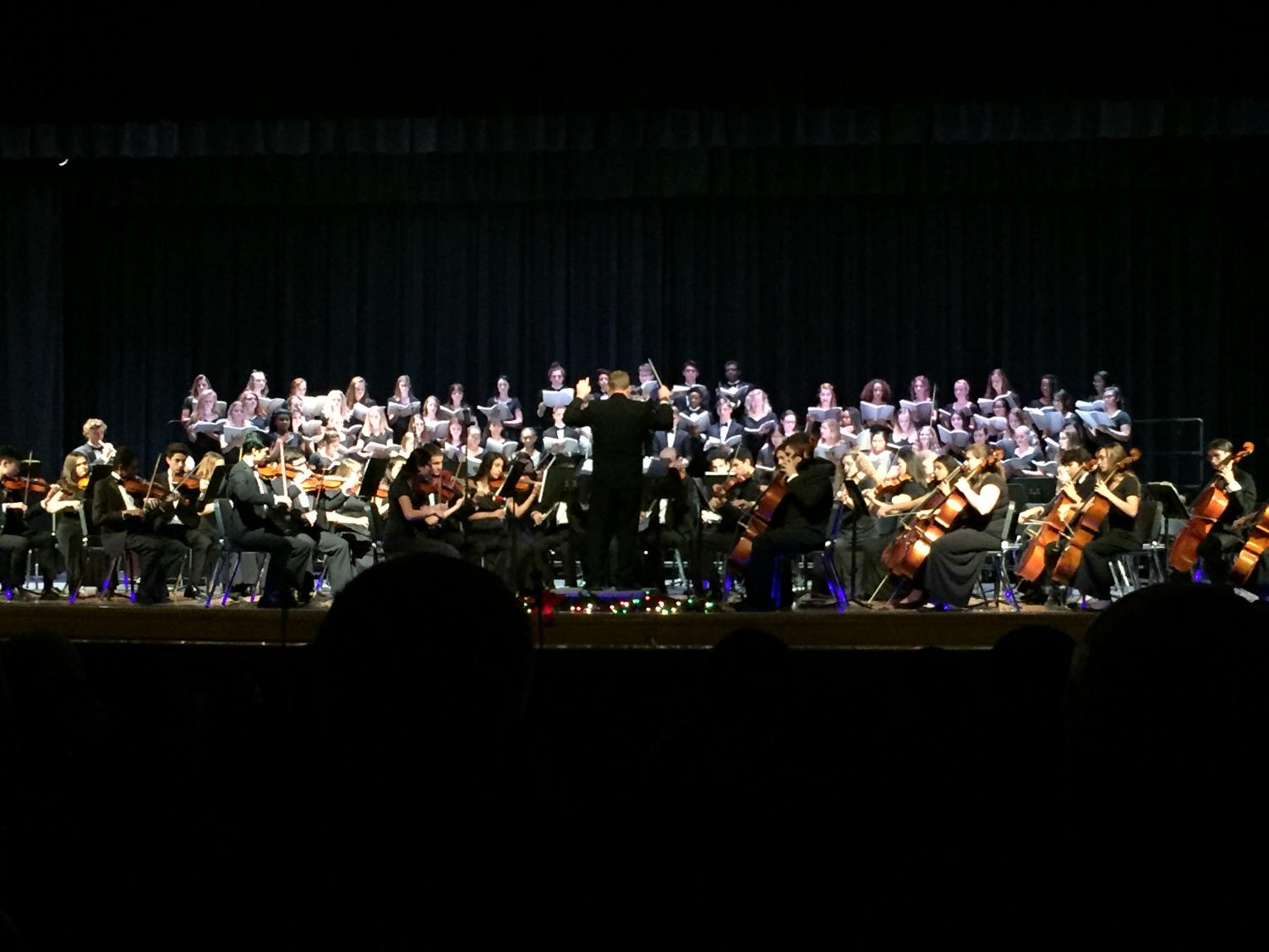 "William Boardman conducting ""Gloria"" for both chorus and orchestra in the auditorium on Dec. 18."
