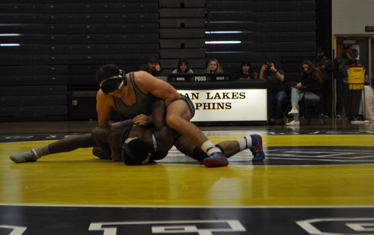 Junior Jake Levine pins a Tallwood wrestler in a wrestling meet at Ocean Lakes on Jan. 9.