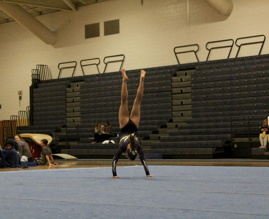 Captain Jess Harris mid-flip during her floor routine on Monday, Jan. 7.