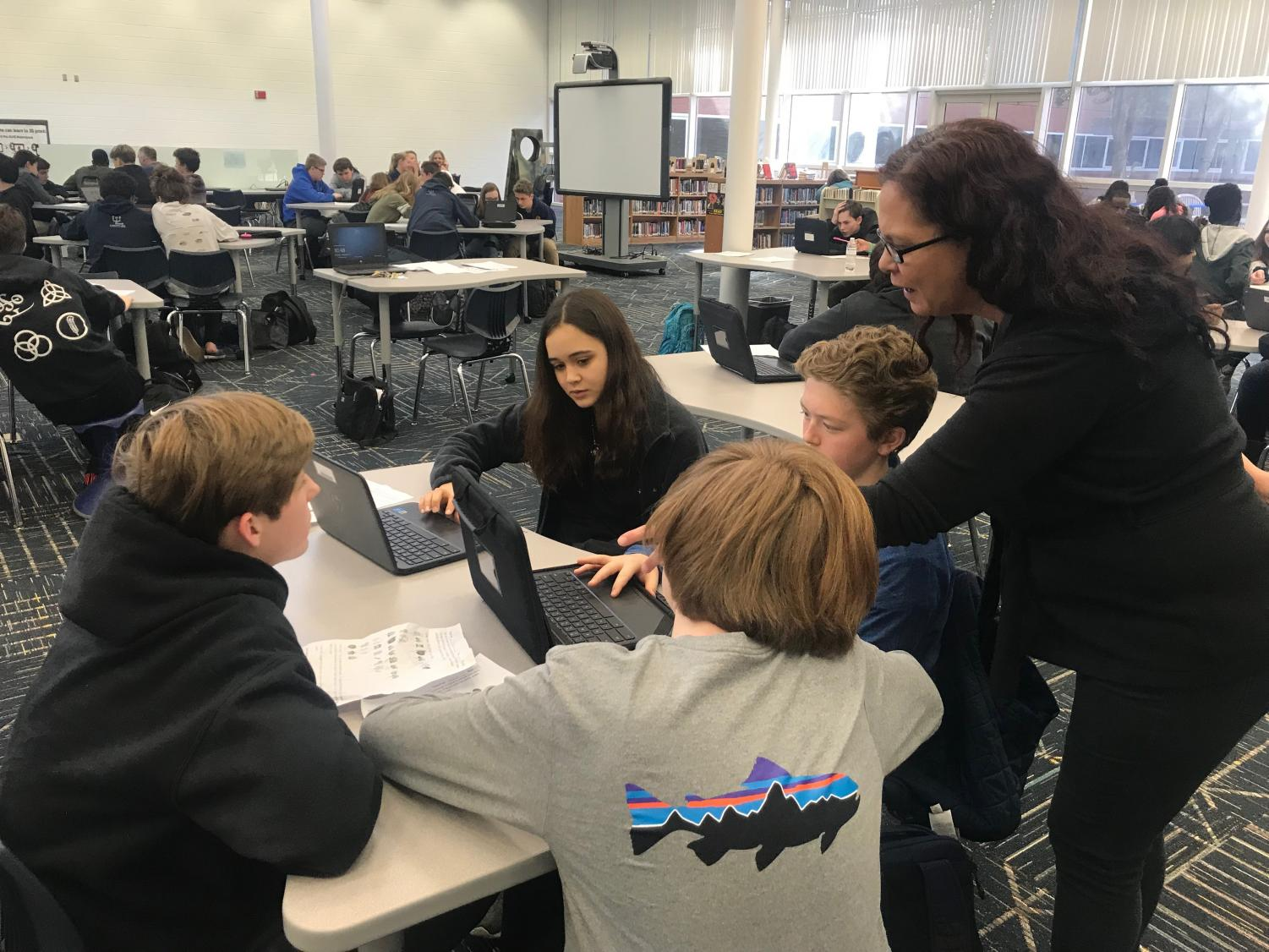 Media specialist Elizabeth Labiak helps Peter Zell's third block freshmen health students during the suicide prevention breakthrough in the library on Friday, Jan. 11.