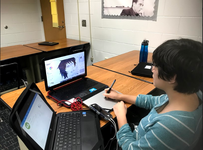 Senior Taylor Dinh draws with her tablet on her personal laptop during downtime in Christina Barnhart's 4A finance class on Wednesday, Jan. 30.