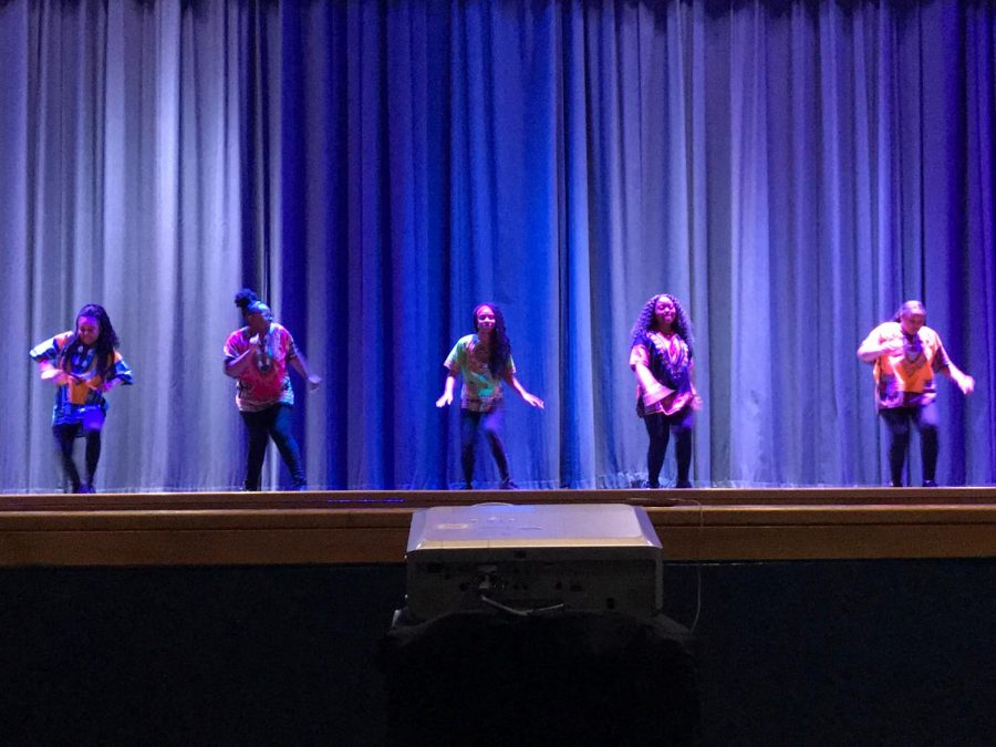 Step Team performs its opening act for the student body in the auditorium during Founders Week.