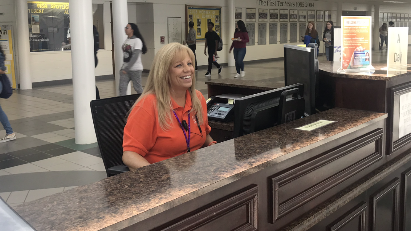Security assistant Rene Ball working at the main security desk during one lunch on Wednesday, Feb. 6.