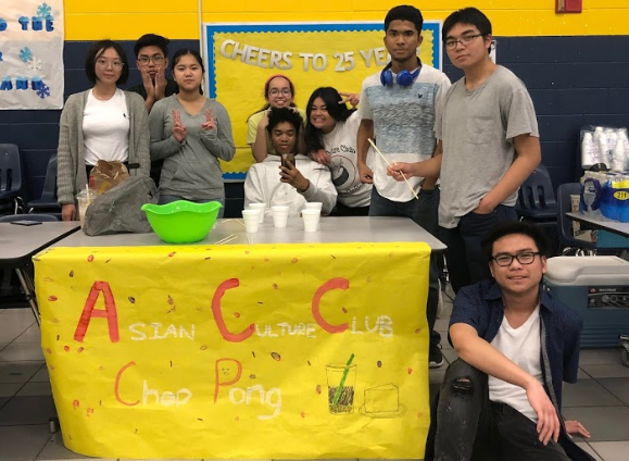 The Asian Culture Club poses at their booth at the Winter Carnival in the cafeteria on February 8, 2019.