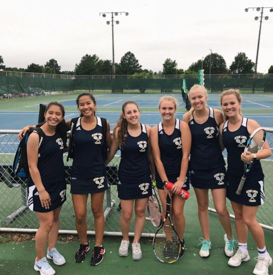 (From left to right) Tennis players Andrea (10),  Lauren Manuel (graduate), Hannah Swirzinski (12), Delanie Hinkley (graduate), Jane Kisselev (12), and Isabelle Weiss (11) pose for a picture at tournament from last year's season at Grassfield High School in late May.