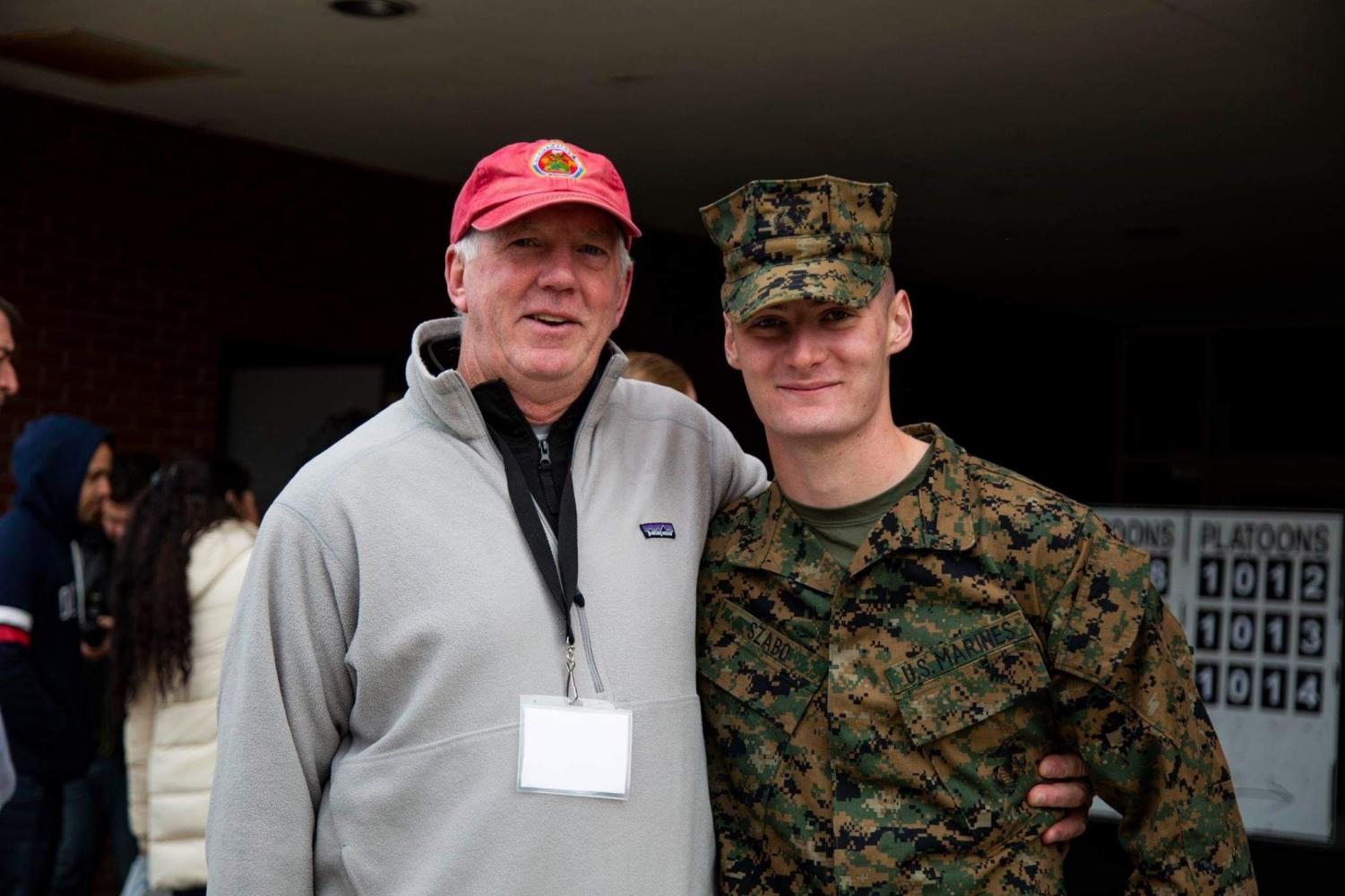 English teacher John Kelly connects with former student Bela Szabo at the Marine Corps boot camp graduation.