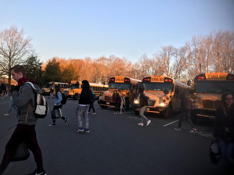 Students walk from their buses in the morning on Feb. 14 in the Ocean Lakes High School parking lot.
