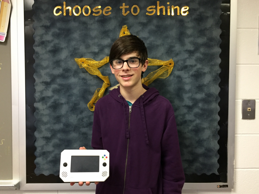 Ian Westlake, junior, holds his 3D printed console that utilizes a Raspberry Pi.