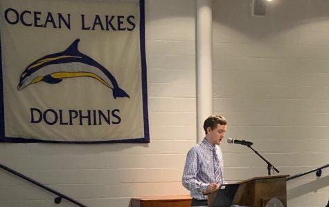 Ethan Boardman giving senior presentation to students in Ocean Lakes Schola.