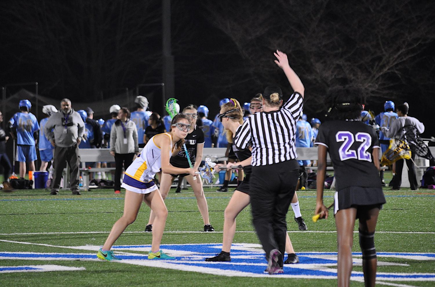 Junior midfielder Denitsa Dimitrova faces off against Menchville High School at Norfolk Collegiate on March 15.