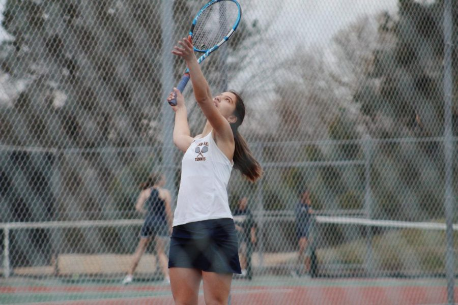 Sophomore+and+number+one+ranked+player+Andrea+Ayala+serves+during+her+singles+match+at+Ocean+Lakes+High+School+on+March+25.+