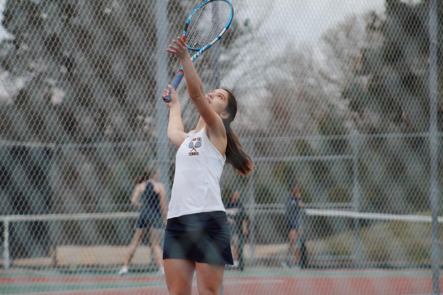 Sophomore and number one ranked player Andrea Ayala serves during her singles match at Ocean Lakes High School on March 25.