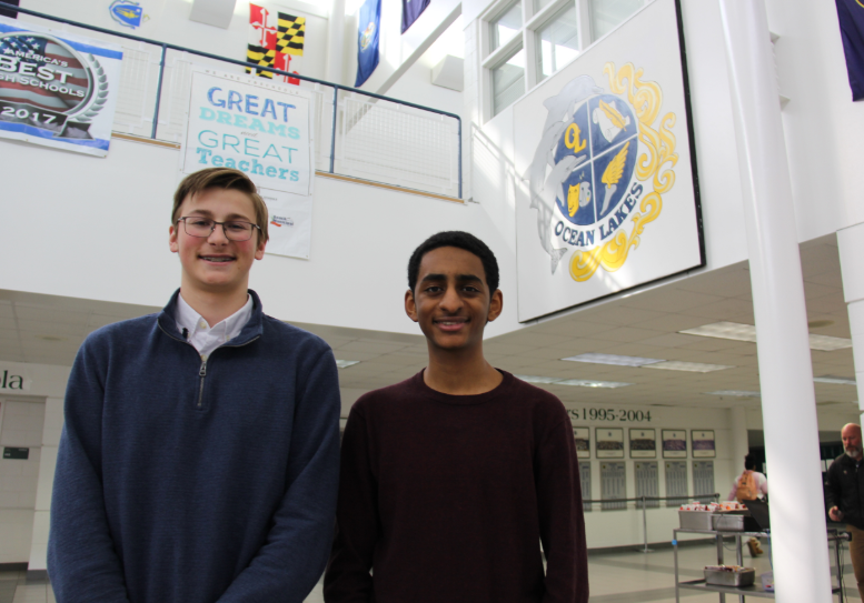 Juniors+Josh+Minter+and+Noah+Siraj+pose+in+the+foyer+shortly+after+being+notified+of+their+perfect+ACT+scores.