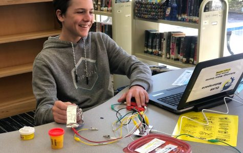 Brennan Cherry works with Makey Makey in the library during Hour of Code. Photo on April 23, 2019