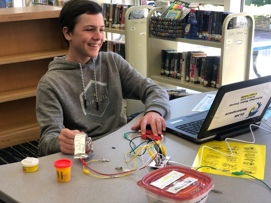 Brennan+Cherry+works+with+Makey+Makey+in+the+library+during+Hour+of+Code.+Photo+on+April+23%2C+2019