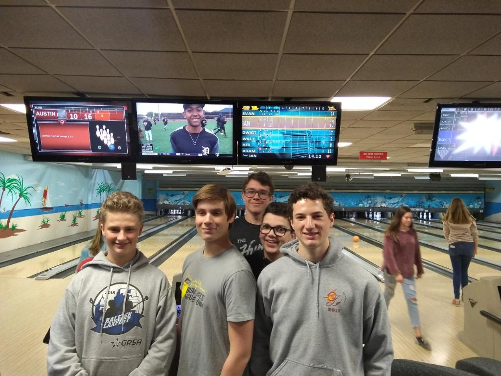 (From right to left) Freshmen Ian Jones, Evan Roney, Billy van Deusen, Alex Wilder, and Adam Caputti pose at the Seaside Lanes Bowling Alley on March 25.