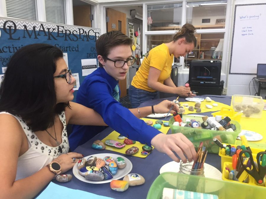 Students Danni Ramdhan, Cody Green, and Brandy Flowers spend time in Makerspace to paint rocks. Intended to spread kindness, students use artistic materials to share inspiration with each other.