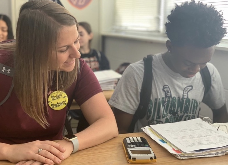 Psychology teacher Carlin Conaway observes sophomore Carlos Smith as he completes some schoolwork. May 10.