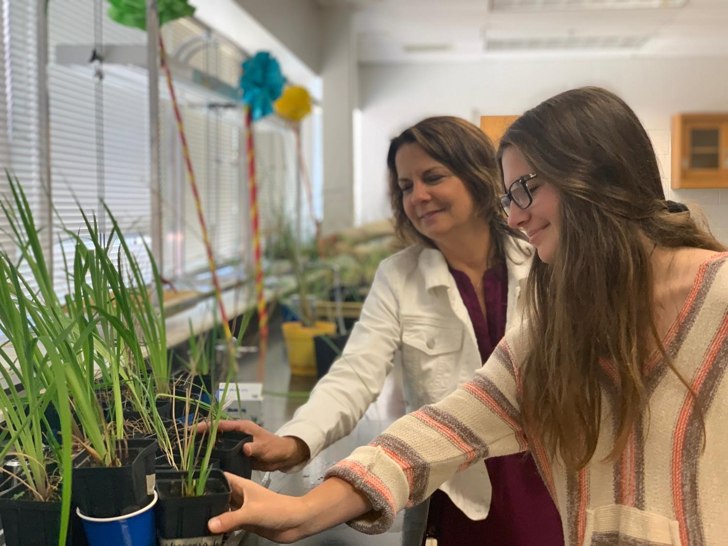 Junior Grace Strzalko and her teacher shadow Fara Wiles admire some plants during Grace's AP Environmental class. May 8.