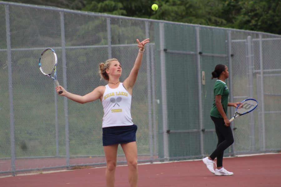 Isabelle Weiss practices her serve before the team's match against Green Run on April 29.