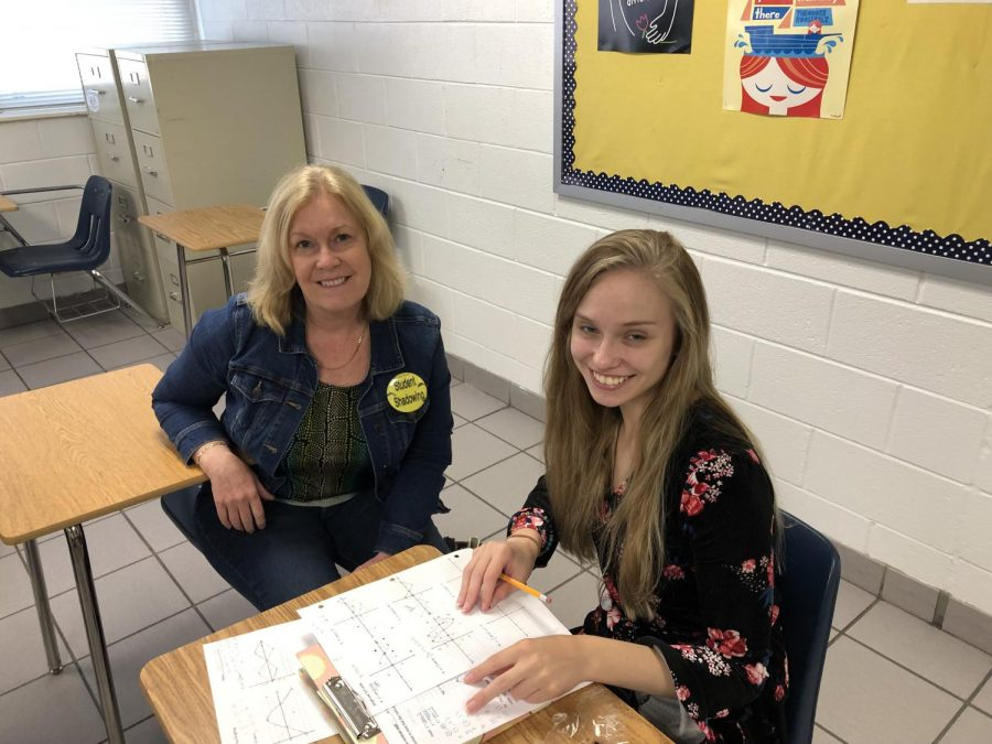 Culinary teacher Carrie Jarvis and her shadowed student Lauren Bacher smile for a picture. May 9.