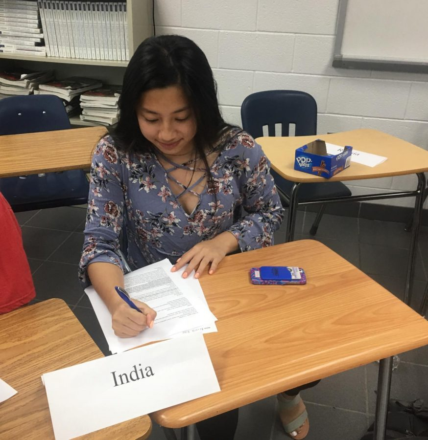 Sophomore Nina Dao writes her position paper during Ocean Lakes first Model UN conference on May 30.