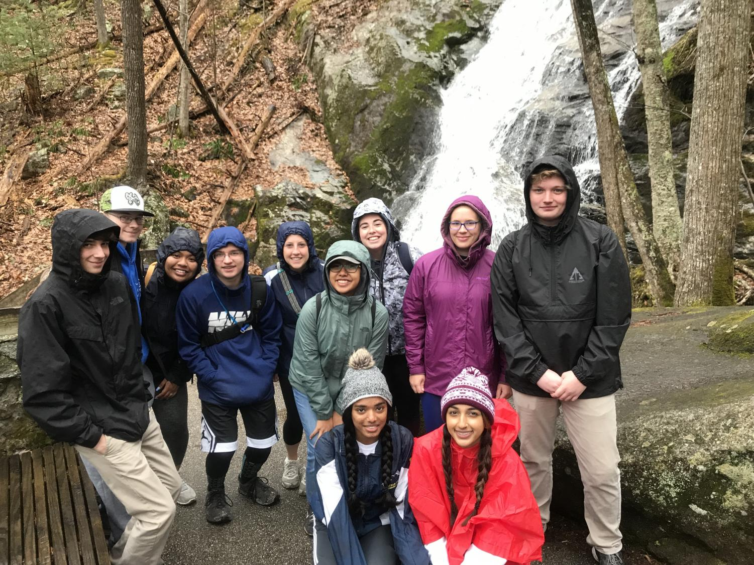 Science teacher Laura Eldredge's magnet physical geology class poses in front of Crabtree Falls in Nelson County, VA.