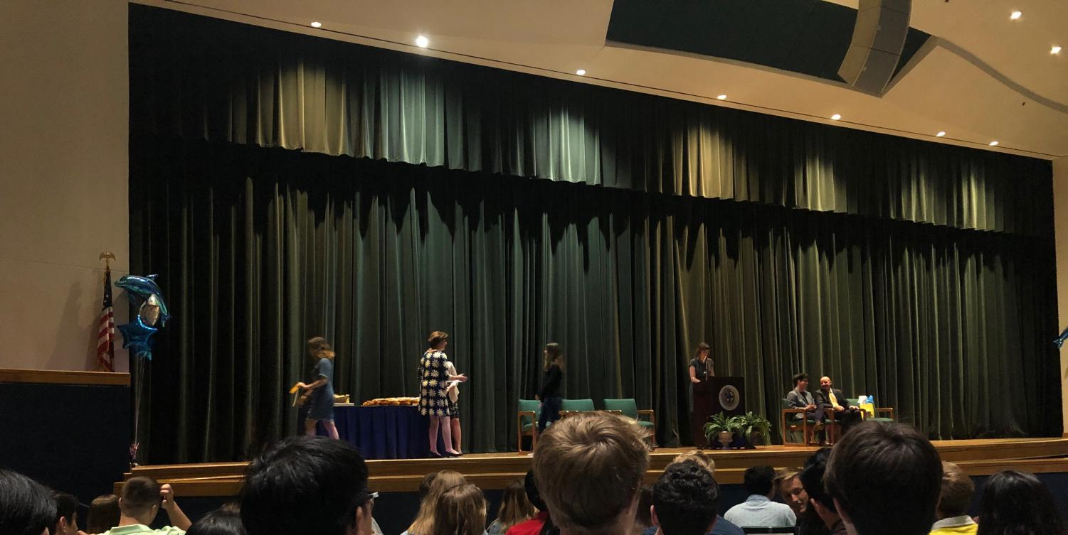 Sophomore Andrea Ayala walks across the auditorium  stage to receive her first academic letter on May 31, 2019.