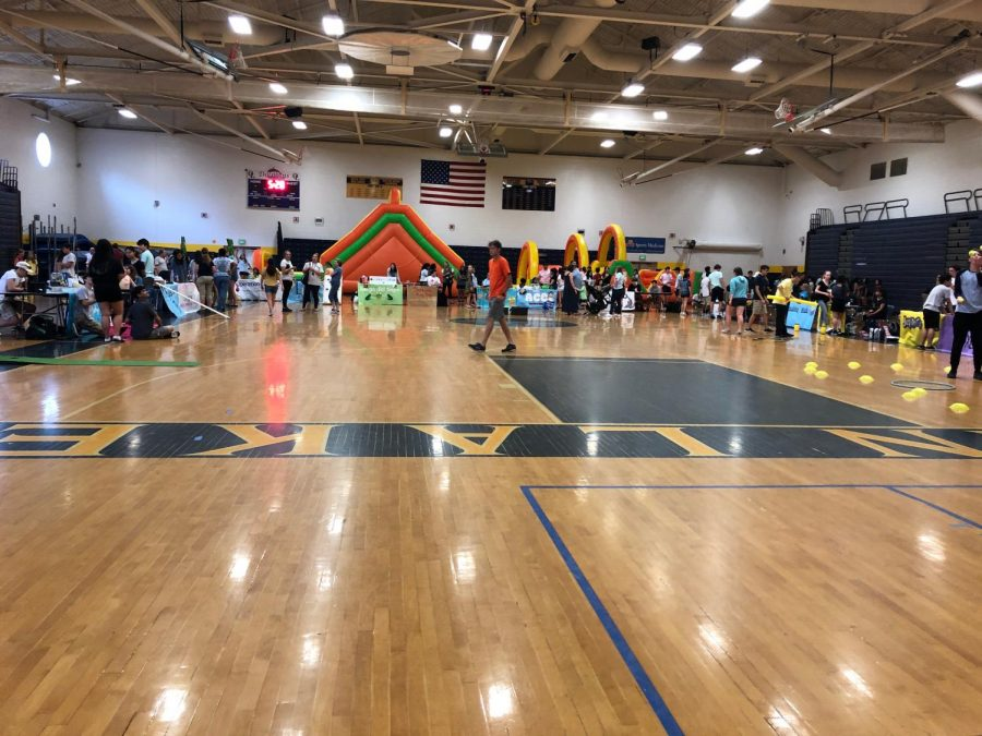 Students, teachers, and staff enjoy the various booths set up during Fin Fest in the gymnasium on May 31.