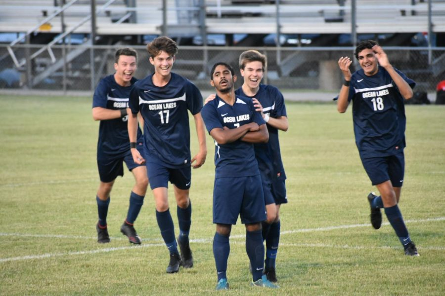 (From left to right) Seniors Rhys Jones, Liam Arseneault, Xzavier Funderburk, junior Troy Daigneau, and senior Matt Harris celebrate after an impressive goal scored by Xzavier.