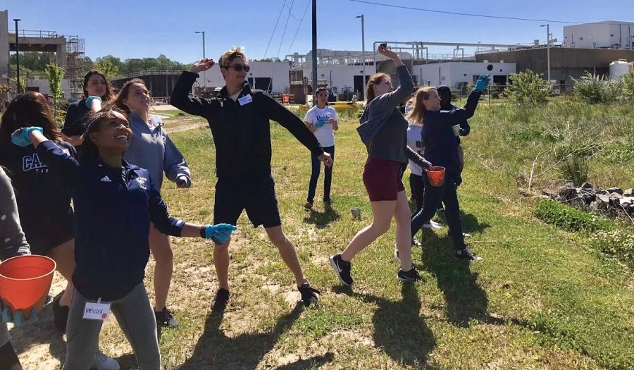 Project Green Teen members and other students throw seed bombs as part of their Earth Action Day field trip at the Atlantic Treatment Plant on April 27.