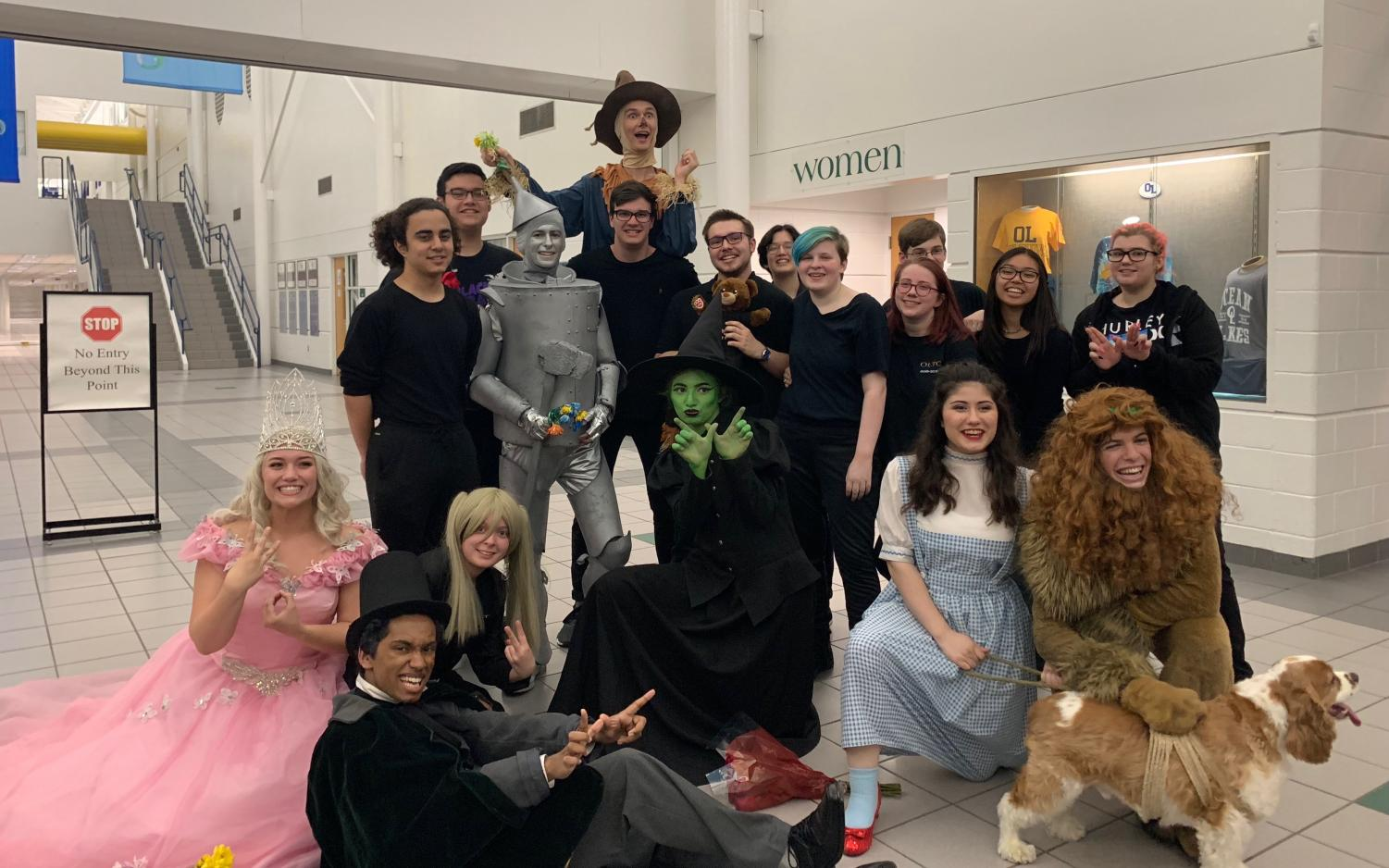 Tech crew and principal step out from the curtain one last time after their final showing of Wizard of Oz. Photo by Imani Saya.