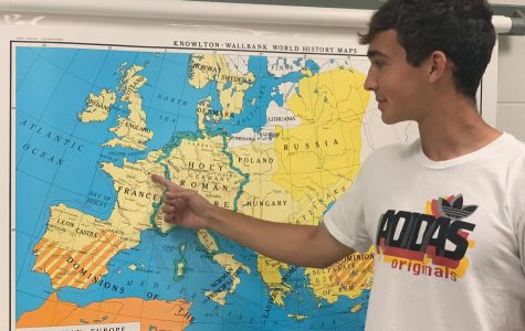 Richard Butzlaff points out the many places he has traveled in Europe in the Social Studies office.