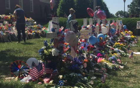 Residents lay flowers, notes, and other memorabilia to honor the victims of the shooting at the Virginia Beach Municipal Center.