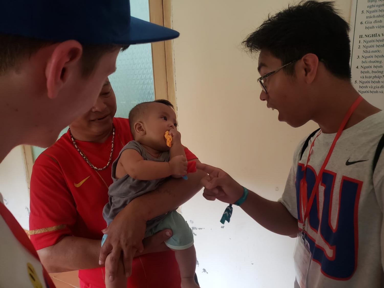 Jondre Macaraeg plays with Kim Ngan at a hospital in Vietnam.