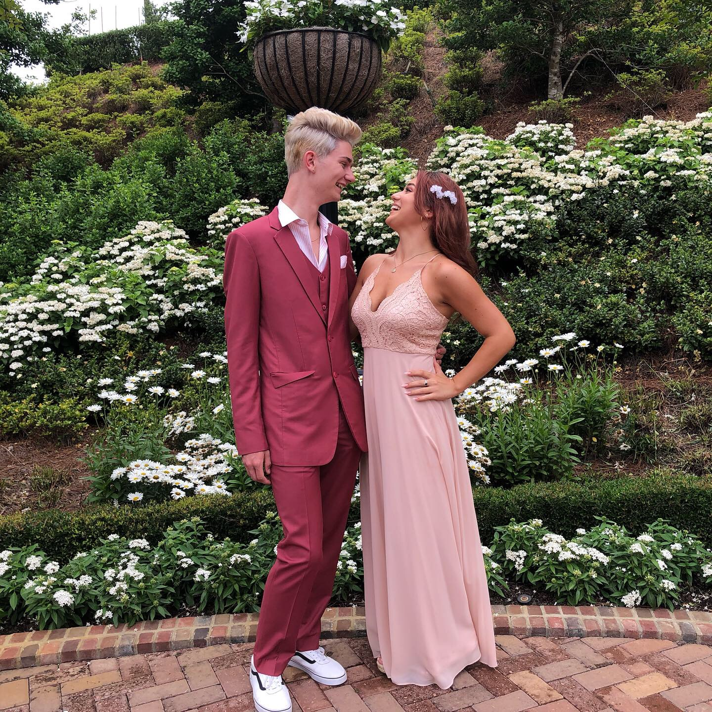 Senior Tristan Hicks (left) and junior Olivia Nery (right) stand for a picture at the Cavalier on June 8, 2019.