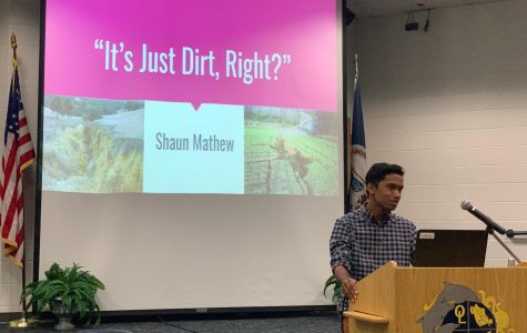 Junior Shaun Mathew begins his presentation on top soil erosion on Tues., May 28 in the schola.