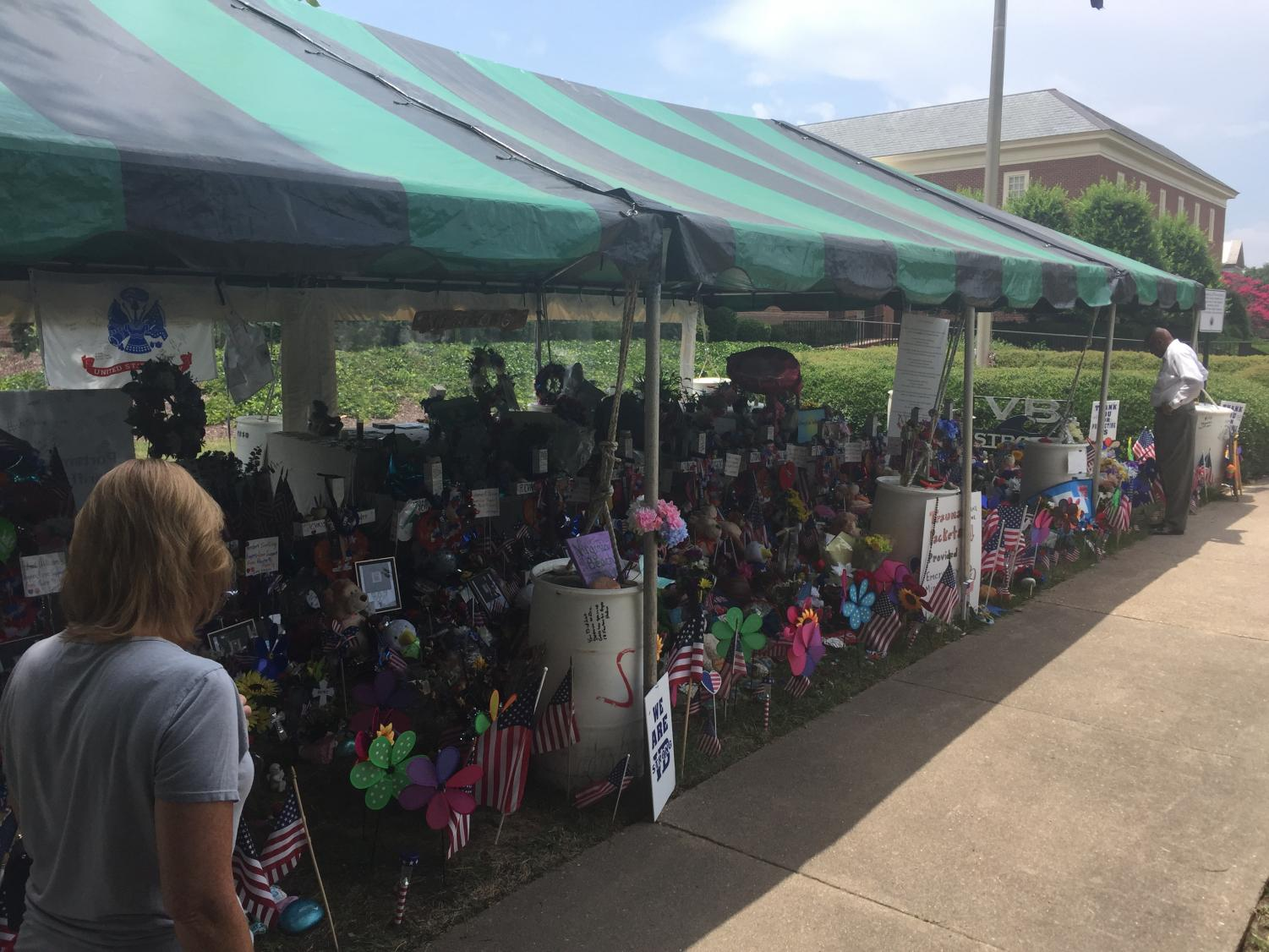 Locals mourn the 12 victims at the Virginia Beach Municipal Center Memorial on July 7.