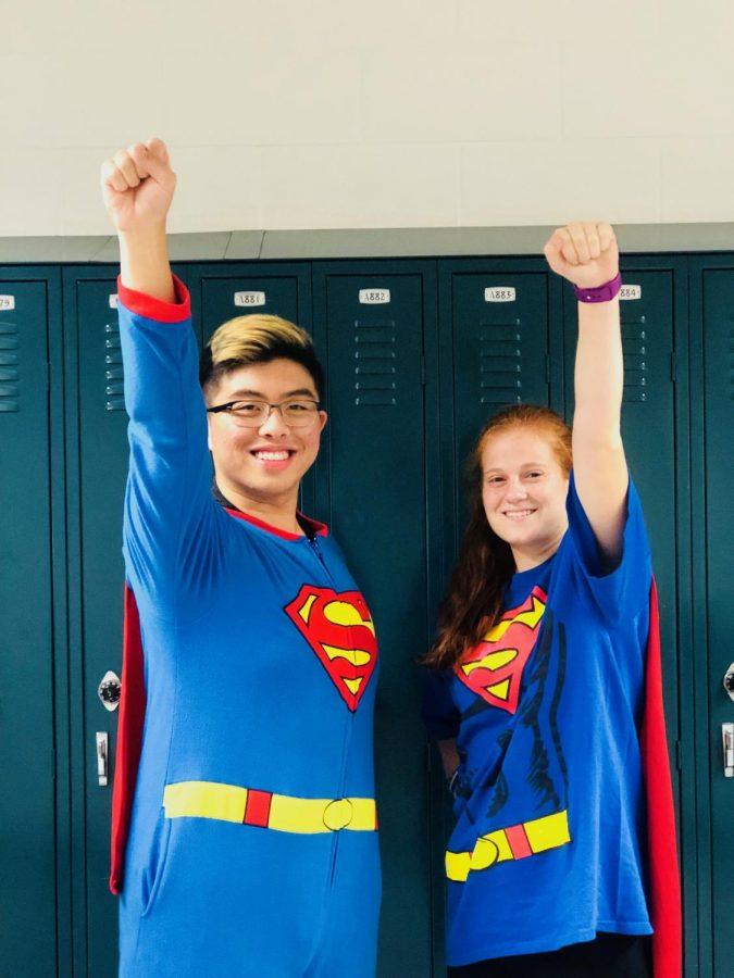 Anna Lisner and Justin Estanislao fly high in Superman onesies.